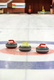 Curling rocks on ice Royalty Free Stock Image