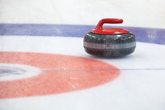 Curling rockson ice Royalty Free Stock Photo