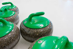 Curling sport stones equipment. Curling stones equipment on the ice Royalty Free Stock Image
