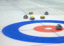 Curling sport stones equipment. Curling stones equipment on the ice Stock Image