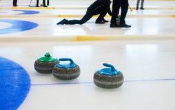 Curling sport stones equipment. Curling stones equipment on the ice Stock Photos