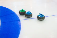 Curling sport stones equipment. Curling stones equipment on the ice Royalty Free Stock Photo