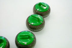 Curling sport stones equipment. Curling stones equipment on the ice Stock Photography