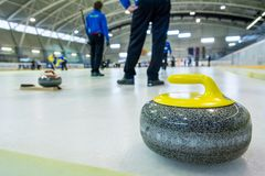 Curling stone on a game sheet. Indoor sport on ice Royalty Free Stock Images