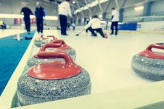 Curling stone on a game sheet. Indoor sport on ice Royalty Free Stock Image