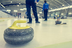 Curling stone on a game sheet. Indoor sport on ice Royalty Free Stock Photos