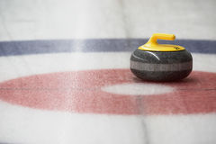 Curling Stone in the House Stock Image