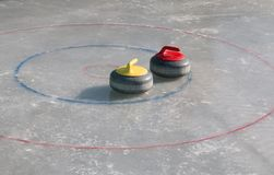 Curling stone. On the ice Royalty Free Stock Image