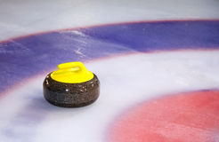 Curling Stone on Ice Royalty Free Stock Photography