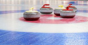 Curling stones. Granite stones for curling game on the ice Stock Photo