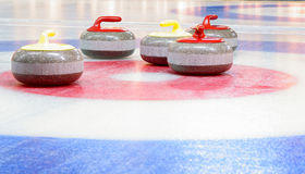 Curling stones. Granite stones for curling game on the ice Royalty Free Stock Photography