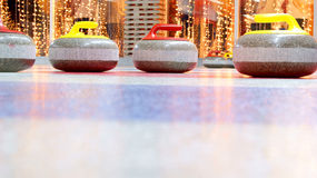 Curling stones. Granite stones for curling game on the ice Stock Photography
