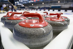 Curling stones Stock Images