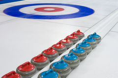 Curling stones. Group of curling rocks on ice Stock Photo