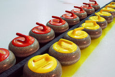 Curling stones on court Royalty Free Stock Images