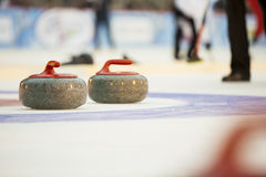 Curling. Stones on the ice Stock Photos