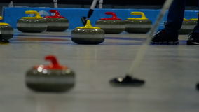 Curling stones on ice stock footage