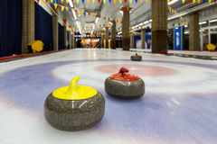 Curling stones on an indoor rink Stock Image