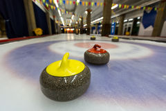 Curling stones on an indoor rink Stock Images