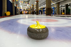 Curling stones on an indoor rink Royalty Free Stock Photo