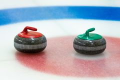 Curling stones in the target on the ice Stock Images
