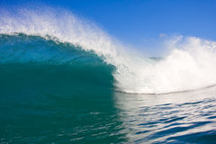 Curling Tropical Wave, View from In the Tube. Amazing Blue Wave Breaks in Clear Tropical Water on Reef with Blue Sky, Surfing Paradise, Hawaii royalty free stock photos