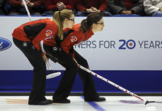 Curling Women Canada Kreviazuk Weagle. Alison Kreviazuk and Lisa Weagle of Canada follow an opponent's shot at the Ford World Women's Curling Championship March Royalty Free Stock Photo