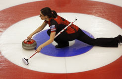 Curling Women Canada Lisa Weagle Rings. A view from above of Canada's Lisa Weagle sliding through the house on a stone delivery at the Ford World Women's Curling Royalty Free Stock Photos