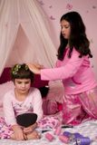 Curls. Adorable girls at a sleepover putting curlers in their hair Royalty Free Stock Images