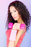Curls hair girl holding weight for exercise. Pretty curls hair girl holding weight for exercise Royalty Free Stock Photography