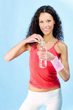 Curls hair woman and bottle of water. Smiled curls hair woman and bottle of water during exercise Stock Photo
