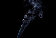 Curls of smoke. Formed curls of smoke on a black background Royalty Free Stock Photos