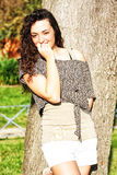 Curly, beautiful shy young girl with nice smile Royalty Free Stock Photo