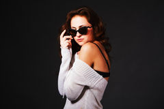 Curly beautiful young girl in sunglasses Royalty Free Stock Images