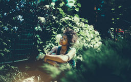 Curly black afro american girl in summer garden stock images