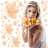 Curly blond girl with orange lily Royalty Free Stock Photo