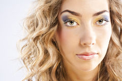 Curly blonde with bright makeup Stock Photos