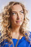 Curly blonde with bright makeup Royalty Free Stock Image