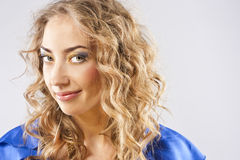 Curly blonde with bright makeup Royalty Free Stock Images