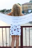 Curly Blonde Girl Standing on the Bridge and Holding a White Sca. Rf Stock Photos