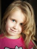 Curly blonde hair young girl stock photography