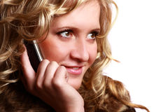 Curly blonde with mobile Stock Images