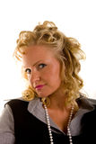Curly Blonde in Pearls Head to Side Stock Image