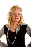 Curly Blonde in Pearls Looking Defiant Stock Image