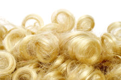 Curly blonde wig Stock Image