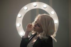 Curly bond hair woman posing, makeup light round. Curly bond hair woman, makeup light round Stock Image