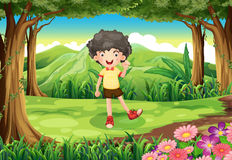 A curly boy at the forest Royalty Free Stock Photo