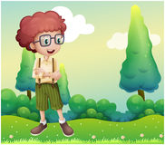 A curly boy standing at the hilltop Stock Image