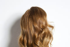 Curly brown hair. Over white background Stock Photo
