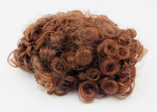 Curly Brown Wig. Reddish brown wig with curls. Isolated Royalty Free Stock Photos